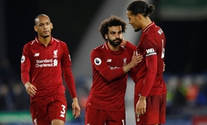 Liverpool's Mohamed Salah shakes hands with Virgil van Dijk at the end of the match. Action Images via Reuters/Carl Recine