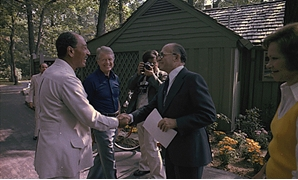 FILE - Anwar Sadat and Menachem Begin shake hands as Jimmy Anwar Sadat and Menachem Begin greet each for their first meeting at the Camp David Summit as Jimmy Carter and Rosalynn Carter watch, 1978 - Courtesy of Jimmy Carter Library - Handout Via Reuters
