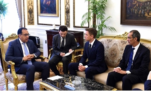 Prime Minister Mostafa Madbouly (l), Russian Minister of Digital Development, Communications and Mass Media Kostantin Noskov, and Minister of Communications and Information Technology Amr Talaat (r) in the Cabinet's headquarters in Cairo, Egypt. March 19,