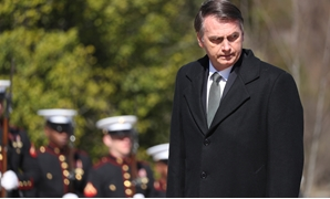 Brazil's President Jair Bolsonaro arrives during ceremonies to lay a wreath at the Tomb of the Unknown Soldier at Arlington National Cemetery during his visit to Washington in Arlington, Virginia, U.S., March 19, 2019. REUTERS/Jonathan Ernst