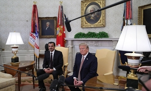 U.S. President Donald Trump meets with the Emir of Qatar Sheikh Tamim bin Hamad Al Thani, in the Oval Office at the White House on April 10. MARK WILSON/GETTY IMAGES