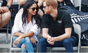 FILE PHOTO: Britain's Prince Harry (R) arrives with girlfriend actress Meghan Markle at the wheelchair tennis event during the Invictus Games in Toronto, Ontario, Canada September 25, 2017. REUTERS/Mark Blinch/File Photo.