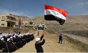 FILE PHOTO: Druze people take part in a rally in Majdal Shams near the ceasefire line between Israel and Syria in the Israeli occupied Golan Heights, overlooking the other side of the border October 6, 2018 REUTERS/Ammar Awad