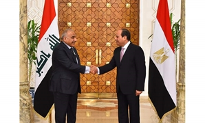 PRESS: (R) Egyptian President Abdel Fatah al-Sisi shaking hands with (L) Iraqi Prime Minister Adil Abdul Mahdi