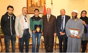 Cairo governor honors Gehad Youssef for rescuing four people in Cairo's al-Zawya al-Hamra – Press photo