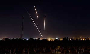 Streaks of light are pictured as rockets are launched from the Gaza Strip towards Israel, as seen from the Israeli side of the border March 25, 2019 REUTERS/Amir Cohen