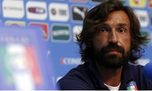Italy's national soccer player Andrea Pirlo looks on during a news conference ahead of the 2014 World Cup at the Casa Azzurri in Mangaratiba June 11, 2014. REUTERS/Alessandro Garofalo