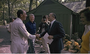 FILE - Anwar Sadat and Menachem Begin shake hands for their first meeting at the Camp David Summit as Jimmy Carter and Rosalynn Carter watch, 1978 - Courtesy of Jimmy Carter Library - Handout Via Reuters