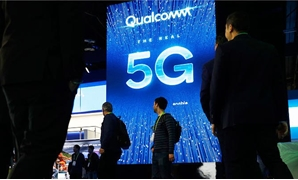 In this Jan. 9, 2019, file photo a sign advertises 5G at the Qualcomm booth at CES International in Las Vegas. (AP)