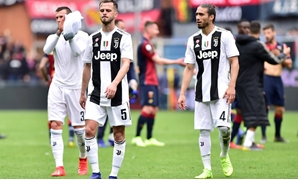 Genoa, Italy - March 17, 2019 Juventus' Miralem Pjanic and Martin Caceres react after the match REUTERS/Massimo Pinca