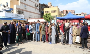 Queues of voters outside polling stations casting their ballot in referendum in Egypt - Egypt Today