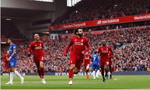 Salah celebrates scoring against Chelsea, Reuters, Phil Noble