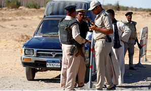 FILE - Security personnel in a security checkpoint in Upper Egypt's Minya