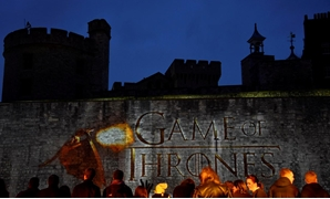 "FILE PHOTO - Fans wait for guests to arrive at the world premiere of the television fantasy drama ""Game of Thrones"" series 5, at The Tower of London"