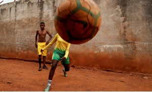 When Gaelle Asheri first started playing soccer in the dirt streets near her home in Cameroon's capital, she was the only girl on the informal neighborhood teams which used stones for goal posts and kept score by chalking results on a wall.