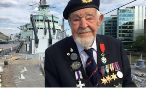 D-Day veteran Richard Llewellyn poses for a photograph on HMS Belfast, on the River Thames in London, Britain May 22, 2019. REUTERS/Alex Fraser