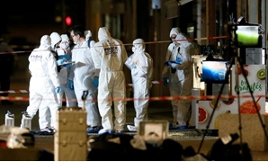FILE PHOTO: Forensic officers inspect the site of a suspected bomb attack in central Lyon