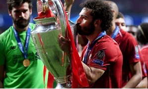 Mohamed Salah with the UEFA Champions League trophy - FILE