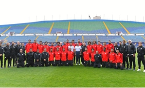 President Abdel Fatah al-Sisi and members of the National Football Team pose for a group photo at the Air Defense Stadium in Cairo, Egypt. June 15, 2019. Press Photo