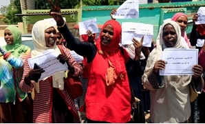FILE PHOTO: Members of Sudan's alliance of opposition and protest groups chant slogans outside Sudan's Central Bank during the second day of a strike, as tensions mounted with the country's military rulers over the transition to democracy, in Khartoum, Su