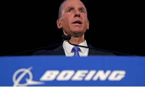 FILE PHOTO: Boeing Co Chief Executive Dennis Muilenburg speaks during a news conference at the annual shareholder meeting in Chicago, Illinois, U.S., April 29, 2019. Jim Young/Pool via REUTERS