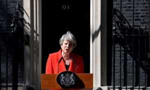 British Prime Minister Theresa May reacts as she delivers a statement in London, Britain - Reuters