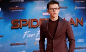 "FILE PHOTO: Actor Tom Holland poses at the World Premiere of Marvel Studios' ""Spider-man: Far From Home"" in Los Angeles, California, U.S., June 26, 2019. REUTERS/Danny Moloshok/File Photo"
