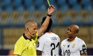 Soccer Football - Africa Cup of Nations 2019 - Round of 16 - Ghana v Tunisia - Ismailia Stadium, Ismailia, Egypt - July 8, 2019 Ghana's John Boye is shown a yellow card by referee Victor Gomes REUTERS/Amr Abdallah Dalsh