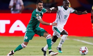 Senegal's Sadio Mane in action with Algeria's Riyad Mahrez. Reuters
