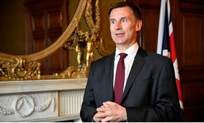 Britain's Foreign Secretary Jeremy Hunt speaks with Reuters at the Foreign Office in London, Britain