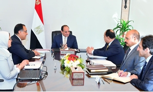 President Abdel Fatah al-Sisi met with a number of ministers on Wednesday to discuss several files including the newly implemented health insurance system - Press Photo
