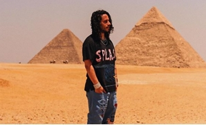 FILE - American rapper Russell Vitale in front of Giza Pyramids - Instagram account