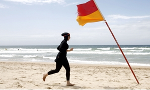 FILE: The decision added that Burkini should not be banned if its material is the same as the one of an ordinary swimming suit.