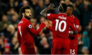 Premier League - Liverpool v Huddersfield Town - Anfield, Liverpool, Britain - April 26, 2019 Liverpool's Mohamed Salah celebrates scoring their third goal with team mates Action Images via Reuters/Jason Cairnduff