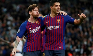 Barcelona's Lionel Messi celebrates with Luis Suarez after scoring their fourth goal. Action Images via Reuters/Andrew Couldridge/File Photo