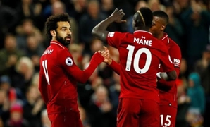 Salah, Mane and Sturridge celebrate a goal for Liverpool, Reuters