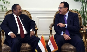Sudanese Prime Minister Abdalla Hamdok meets with Egyptian Prime Minister Mostafa Madbouli (R) - Press photo
