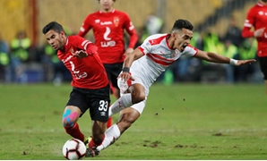 File- Al-Ahly's Nasser Maher and Zamalek's Youssef Obama battle for the ball, Reuters