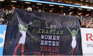 Supporters hold a banner reading 'Let Iranian women enter their stadiums' during the football match between Sweden and Iran at the Friends Arena in Solna near Stockholm in this March 31, 2015 file photo. (AFP)