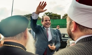 President Abdel Fatah al-Sisi greeted Egyptians who received him at the airport after his arrival from the United States of America