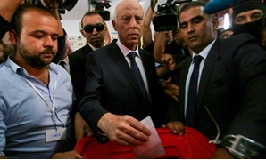 Tunisian presidential candidate Kais Saied casts his vote at a polling station during a second round runoff of a presidential election in Tunis, Tunisia October 13, 2019. REUTERS/Amine Ben Aziza
