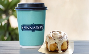 Coffee and a cinnabon roll- press photo