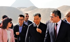 Minister of Antiquities accompanying the Chinese delegation during a tour to the Giza Pyramids - ET