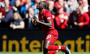 Soccer Football - Premier League - Liverpool v Wolverhampton Wanderers - Anfield, Liverpool, Britain - May 12, 2019 Liverpool's Sadio Mane celebrates scoring their first goal REUTERS/Phil Noble