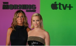 "FILE PHOTO: Reese Witherspoon (R) and Jennifer Aniston arrive to the global premiere for Apple's ""The Morning Show"" at the Lincoln Center in the Manhattan borough of New York City, U.S., October 28, 2019. Picture taken October 28, 2019. REUTERS/Eduardo Mu"