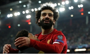 FILE PHOTO: Soccer Football - Champions League - Group E - FC Salzburg v Liverpool - Red Bull Arena Salzburg, Salzburg, Austria - December 10, 2019 Liverpool's Mohamed Salah celebrates scoring their second goal with Alex Oxlade-Chamberlain Action Images v