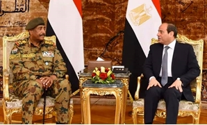 FILE - President Abdel Fattah al-Sisi meets with Sudanese Transitional Military Council Chairman Abdel Fatah al-Burhan in Cairo on Saturday, May 25, 2019- press photo