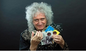Guitarist Brian May of band Queen poses with a 5-pound in this undated picture obtained by Reuters on January 17, 2020. Courtesy of Queen Productions LTD/via REUTERS