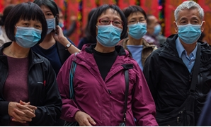 People wearing masks visit Wong Tai Sin temple on the first day of the Lunar New Year of the Rat in Hong Kong on January 25, 2020, as a preventative measure following a coronavirus outbreak which began in the Chinese city of Wuhan. Hong Kong on January 25