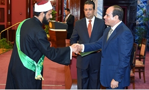 FILE - During the ceremony, President Sisi honored 10 of the Quran reciters from many countries - Sherif Abdel Moneim, June, 2018